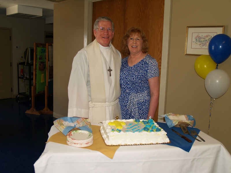2014-06-15 CLC Pastor Charles Gustafson 35th Ordination anniv serv with Kathy P6158449